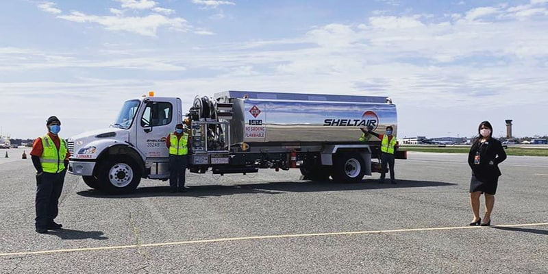 Sheltair fueling truck with employees standing in front